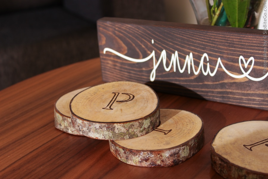 Black ink on wood monogrammed wood coasters - the perfect gift for the bride and groom who have everything. Get more garden wedding ideas at sipbitego.com.