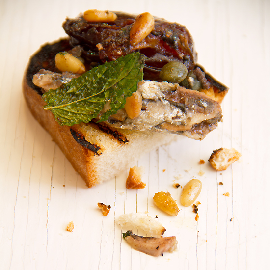 White anchovies with dates and capers on toast