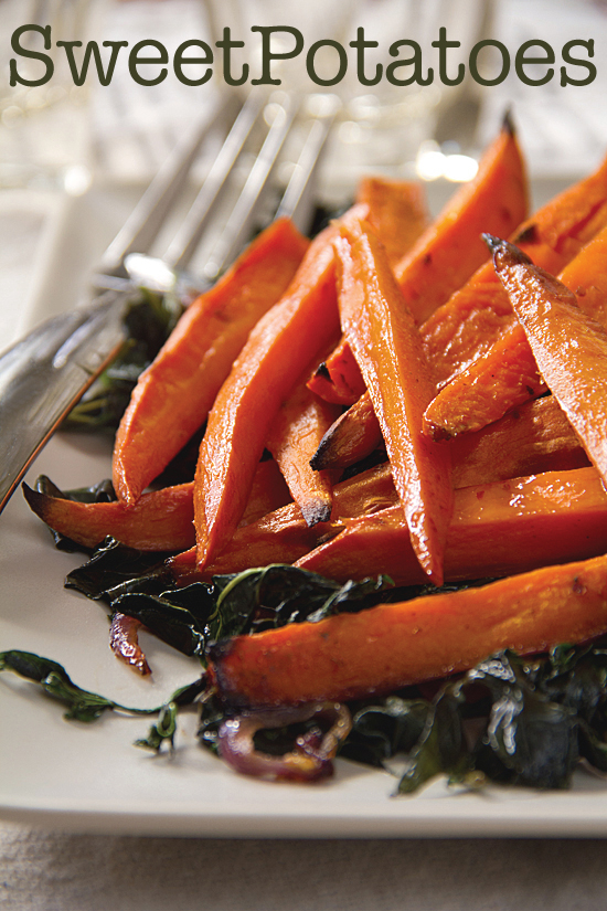 Spicy glazed sweet potatoes on a bed of sweet potato greens