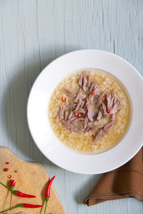 Lamb and Rice Soup with Chile Peppers and Lemon Wedges