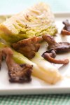 Butter-Braised Baby Leeks with Brussels Sprout Crowns and Oyster Mushrooms