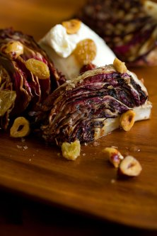 Grilled Radicchio with Burrata, Golden Raisins, and Hazelnuts
