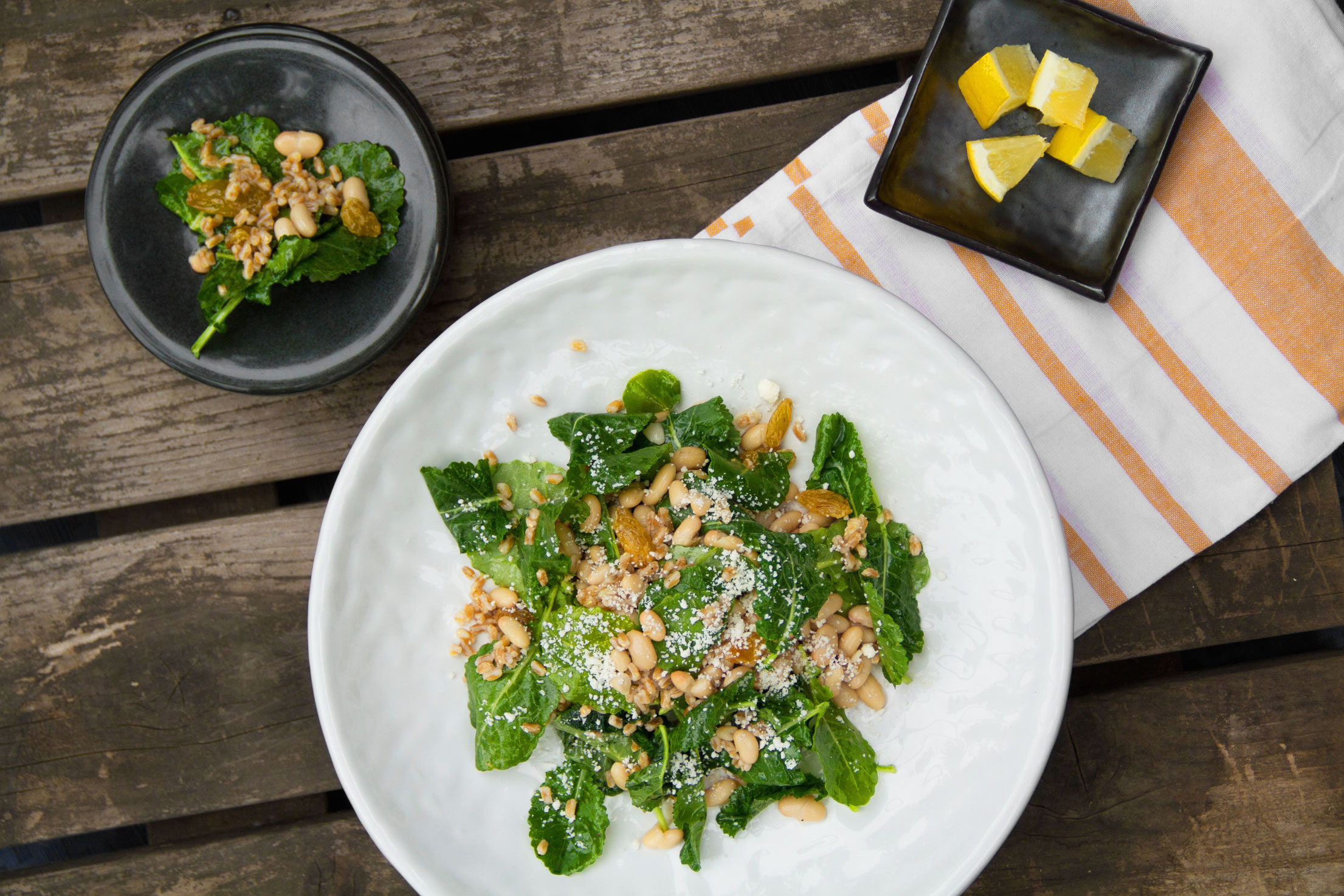Baby Kale Salad with White Beans, Farro, and Golden Raisins