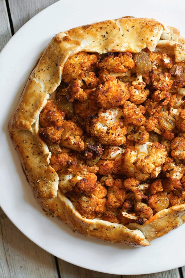 Cauliflower Galette with Labneh, Harissa, and Pickled Raisins