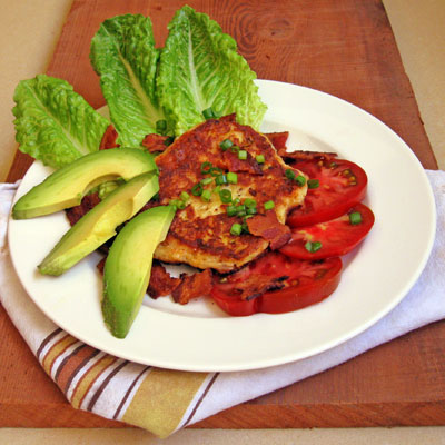 cheddar cheese opancakes salad with tomato and avocado