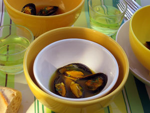 a picnic of steamed mussels saffron garlic mustard bread