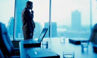 Businessman standing alone in a conference room