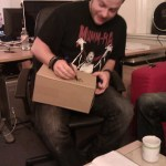 Dr Hell signing Kev's cardboard box for The Rock Train