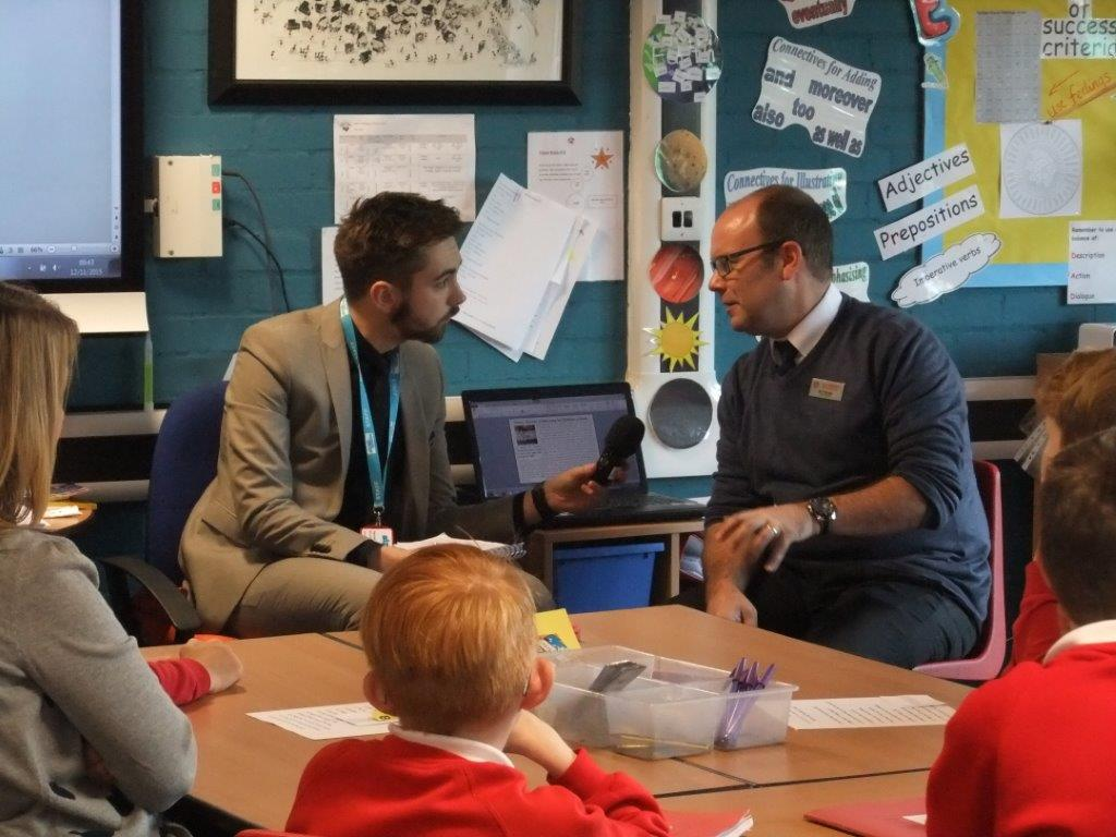 Siren FM's Jarrad Johnson with Mr Thursby in the classroom. Photo: Adrienne Hoddinott