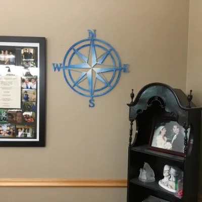 compass rose sign on wall