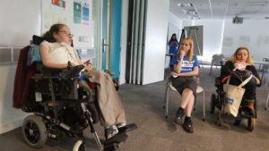Fleur leading the workshop, shes in a wheelchair but theres another woman in the picture