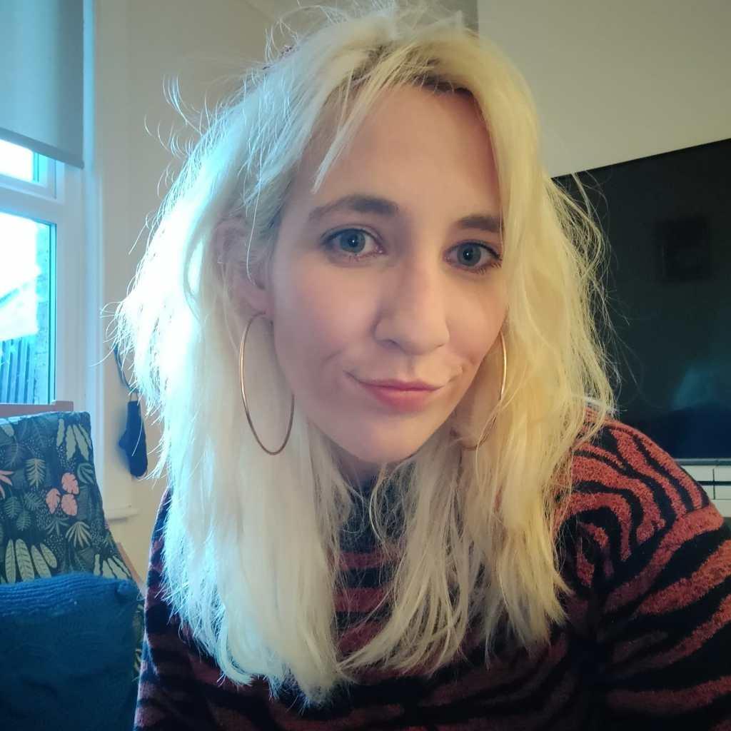 white blonde woman with hoop earrings