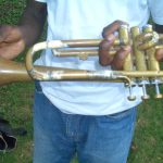 Trumpet held together by tape and glue