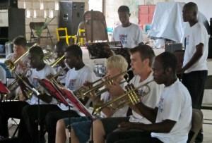 Alec Goodrich, Reid Kellogg and Fanfare performing at final concert