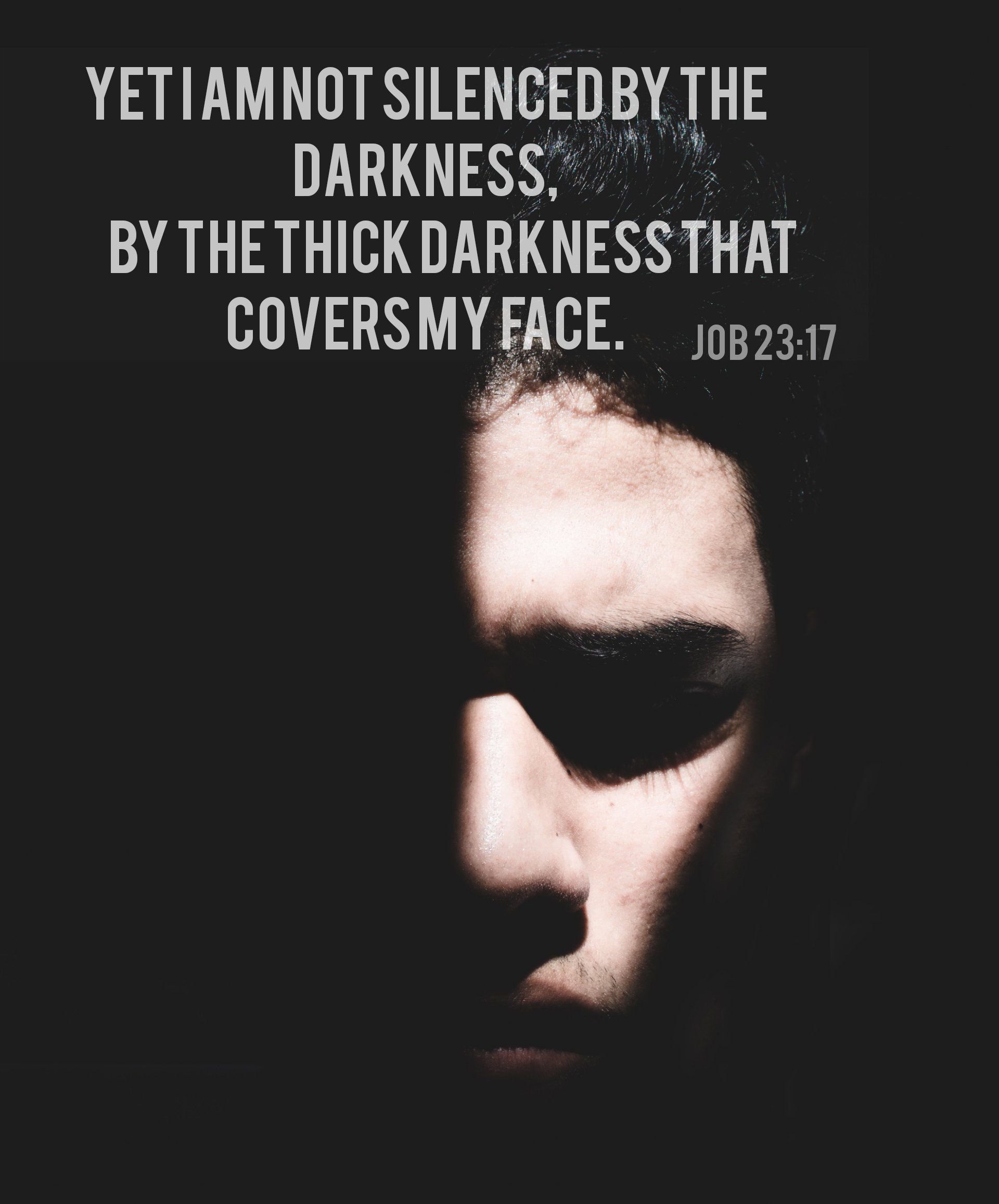 a face covered by dark shadow