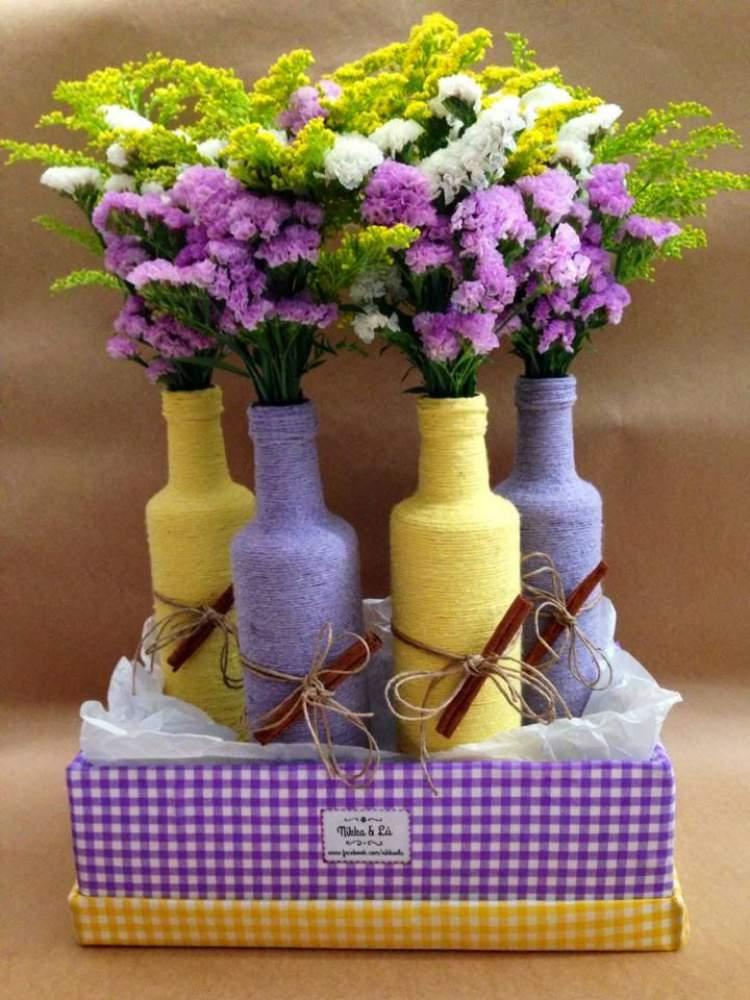 vasos para plantas e flores feitos de garrafas encapadas com barbante
