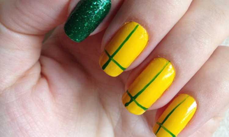 Unhas geométricas com as cores do Brasil