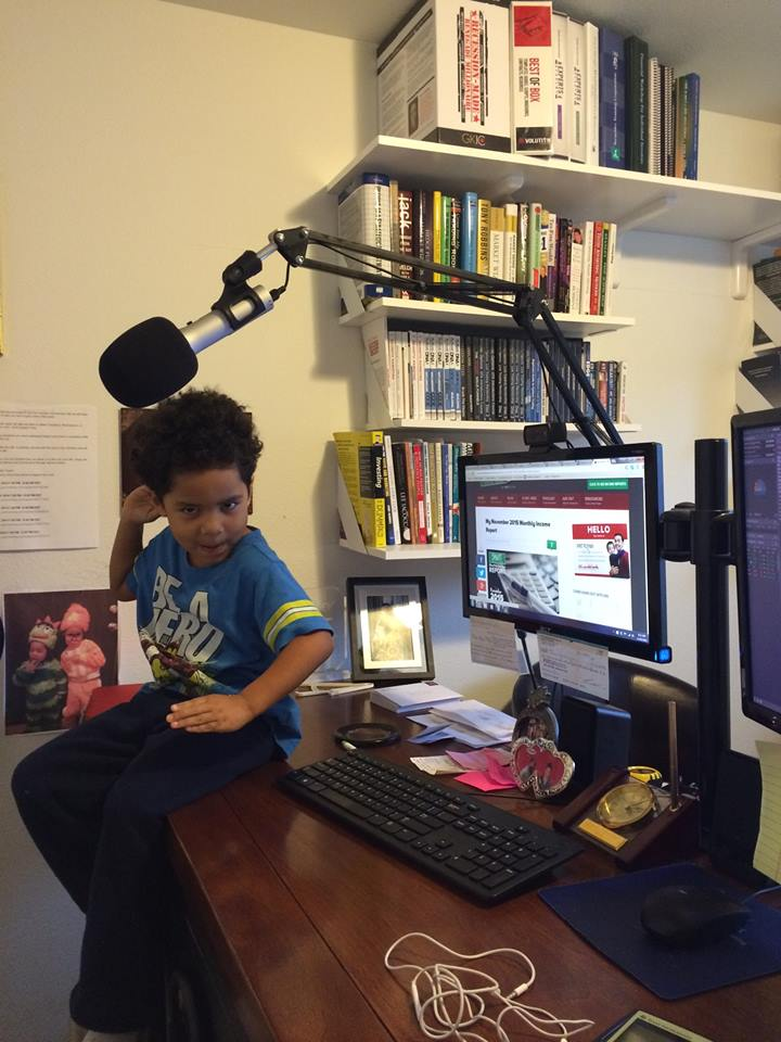 Travis's work-from-home desk. His son Noah thinks it's a cool place to hang out!