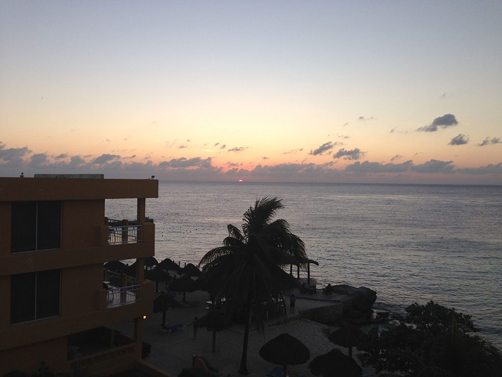 Office with a view: Dan loves to work from the balcony at the Playa Azul Hotel in Cozumel, Mexico
