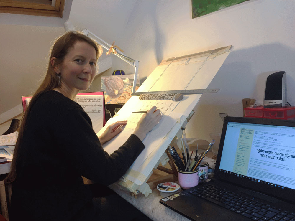 Katharine at work in her home office.