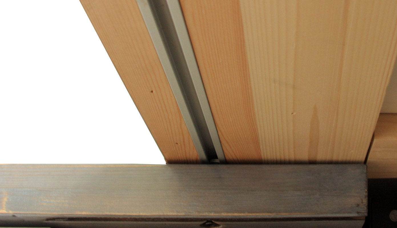 Track embedded in the underside of the desk for the task desk to slide along