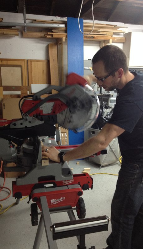 Adam and his new chop saw...the first test cut