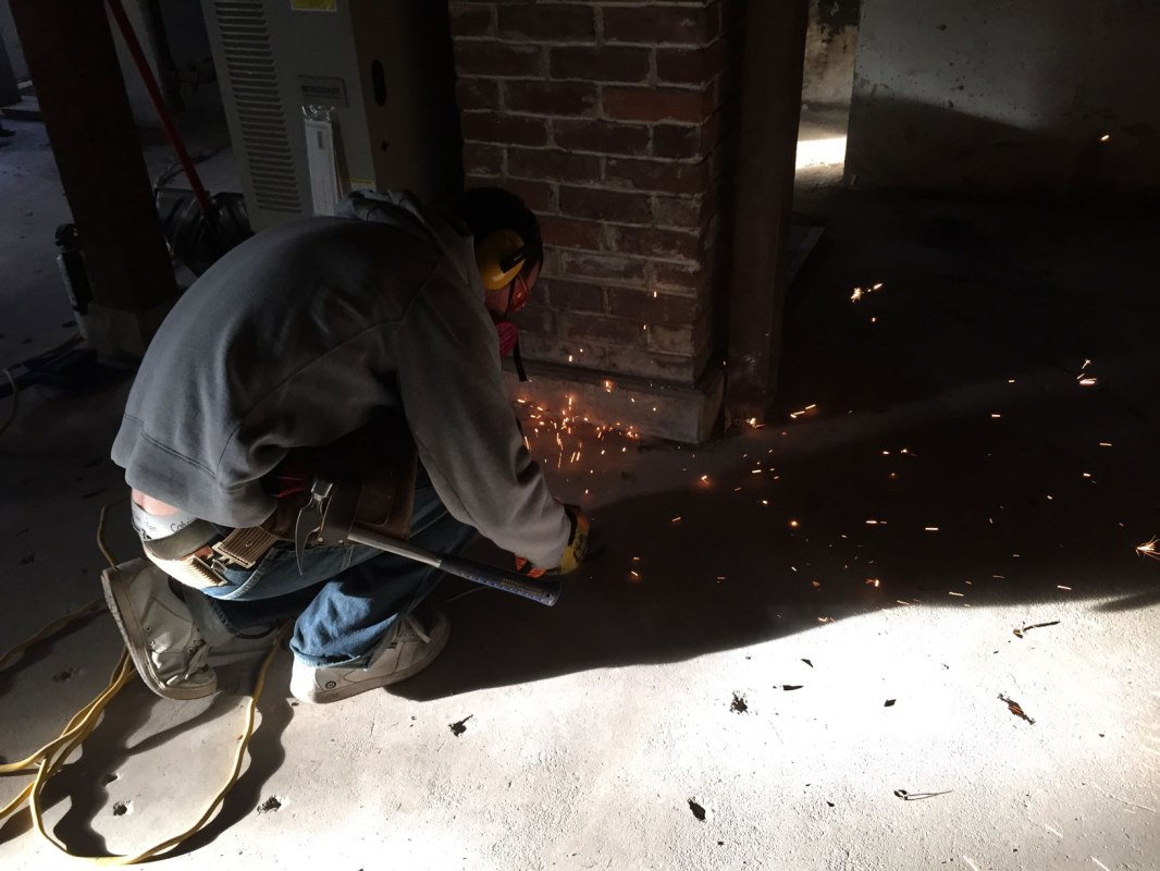 Grinding nails off the concrete floor
