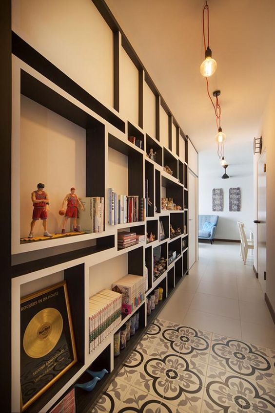 book storage and display area along a corridor. Clever storage solutions