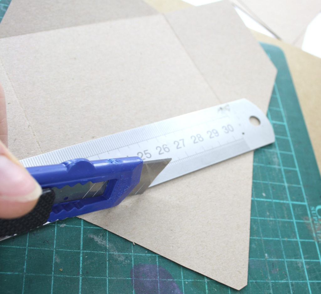 step 3 using the back of your knife score the fold lines at all sides of your envelope