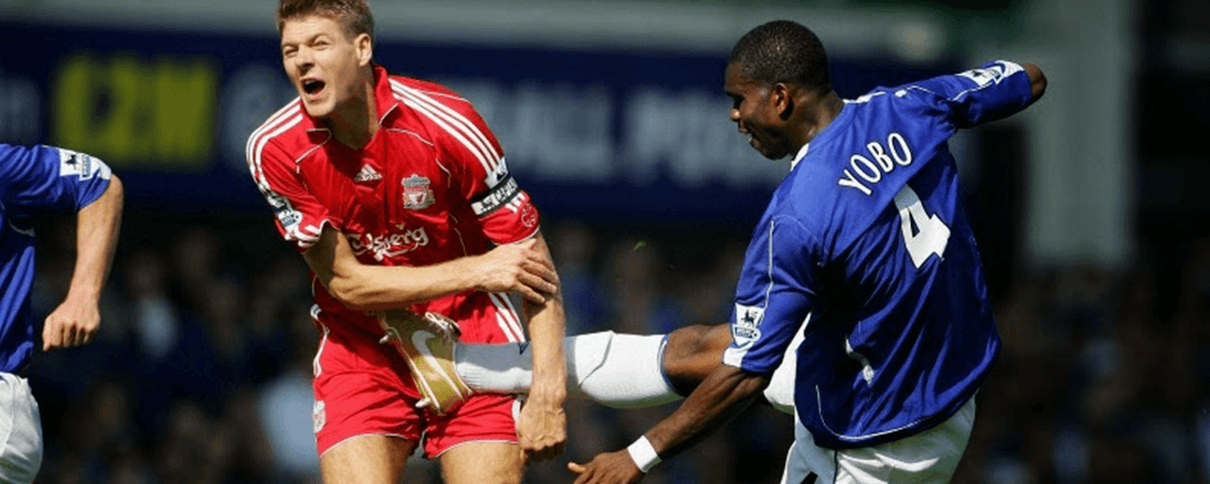 Steven Gerrard and Joseph Yobo during the Merseyside derby between Liverpool FC and Everton FC (Source: Football Off the Pitch)