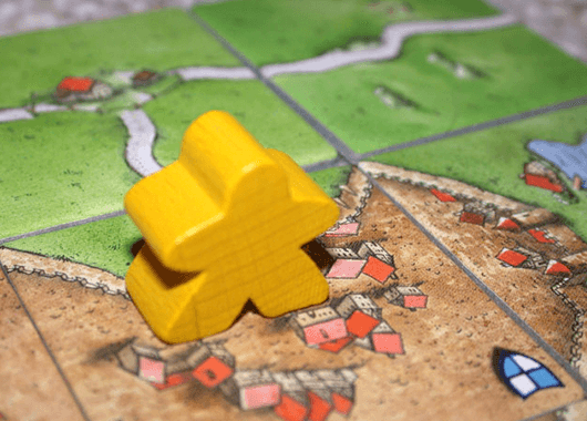 "The classic Carcassonne ""meeple"" (Source: Klo~enwiki/Wikimedia Commons)"