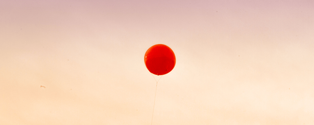 Red Balloon Floating Away