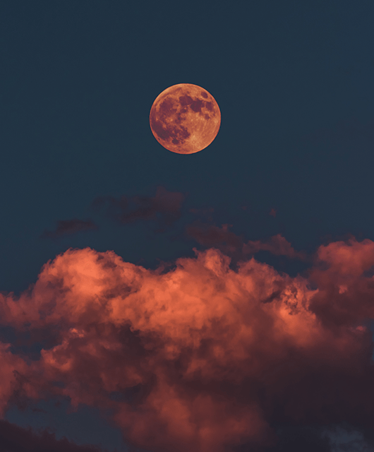 Red Full Moon Over Clouds