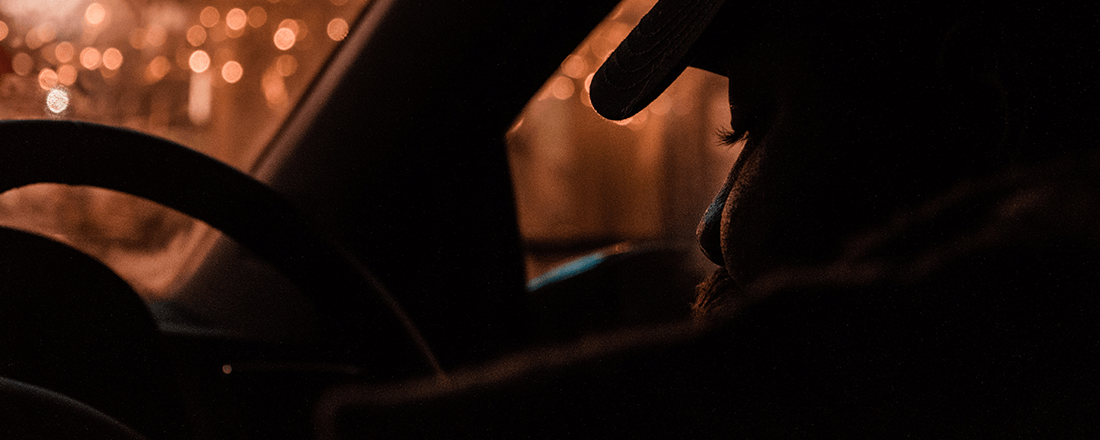 Silhouette of Person Waiting in Car