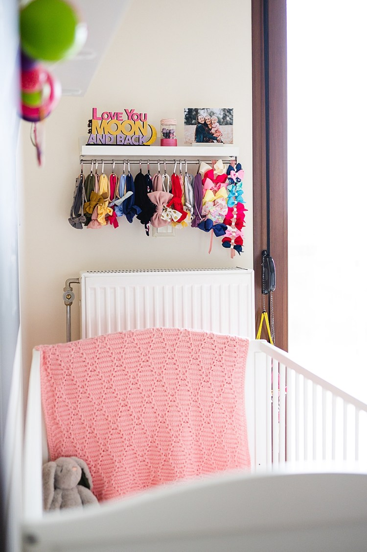 Easy & Cheap DIY Headband Holder   Easy DIY Headband Holder with shelf   Easy DIY Bow Holder   Storage Solution for Headbands and Bows   Hairbow Holder   How to organize baby headbands   Check out this easy and cheap DIY headband storage solution on the Six Clever Sisters blog!