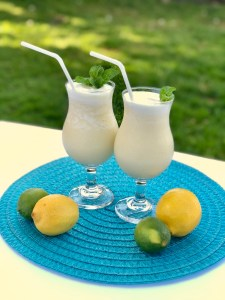 Tropical Drink | Summer Drink Recipe | Coconut Smoothie | Pineapple Drink | Fruity Drink | Drink Recipe | Easy Punch Recipe | Caribbean Breeze Drink | If you love tropical flavors and creamy sweet drinks, this Caribbean Breeze Drink is the recipe for you! Find it at SixCleverSisters.com.