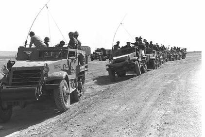 column of armoured half-tracks manned by reservists in the South