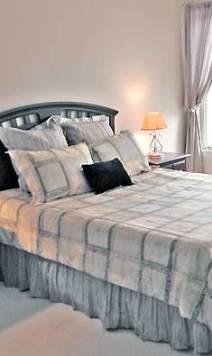 bedroom after staging by Debra Gould