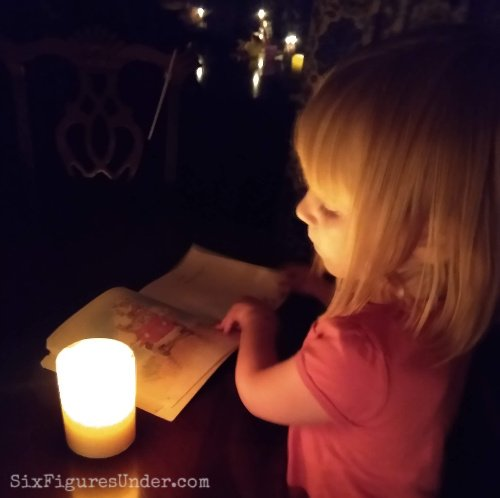 Reading by candlelight during a public safety power shutoff