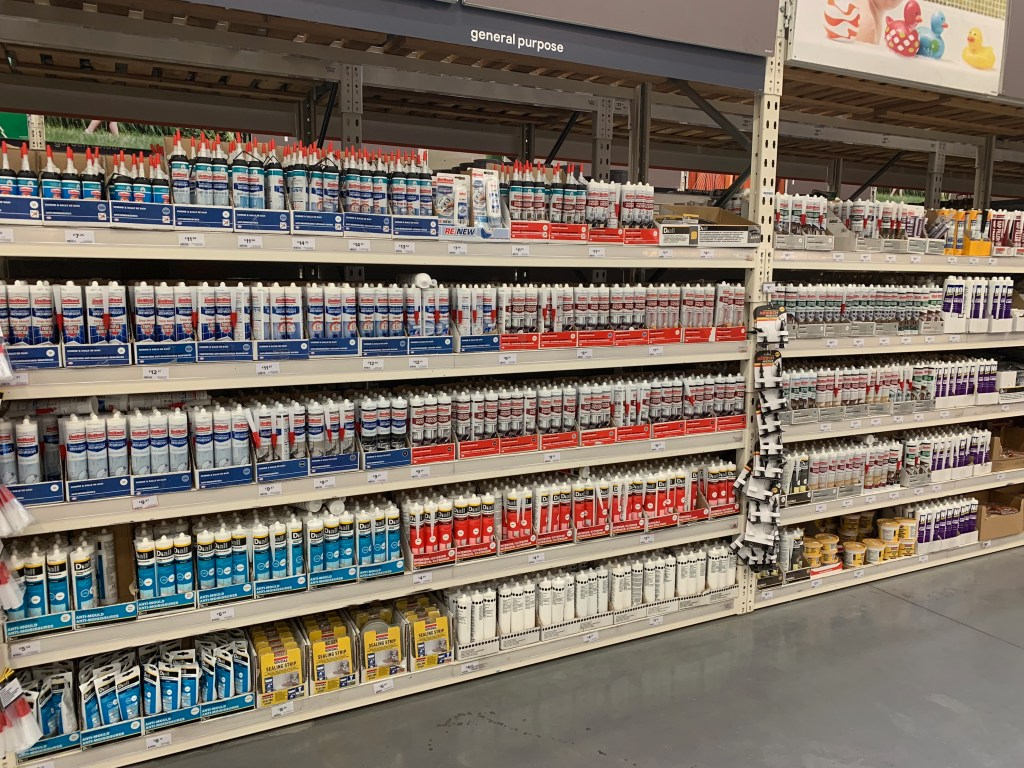 Adhesives & Sealants Packaging Displayed on Shelves