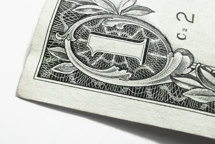 Top left corner of a banknote of 1 US dollar. Macro
