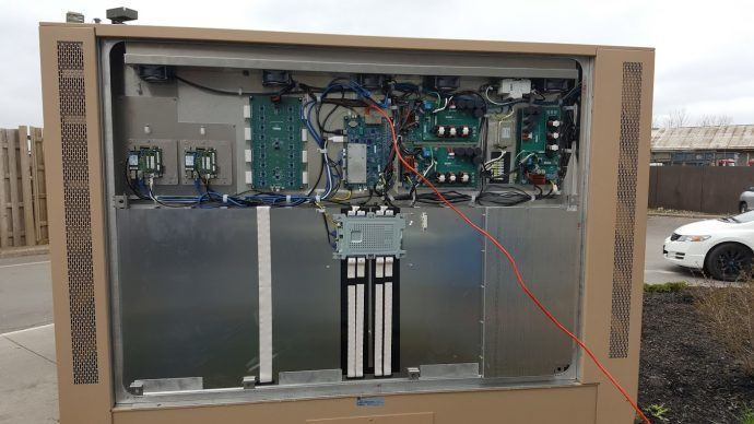 "Inside back panel of 84"" drive through menu display. Bottom half is all a heat exchanger."