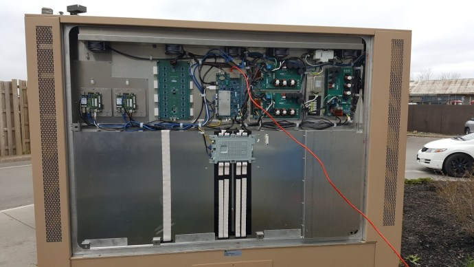 """Inside back panel of 84"""" drive through menu display. Bottom half is all a heat exchanger."""