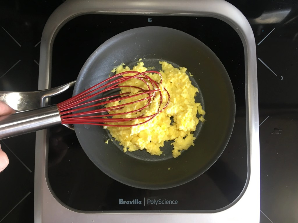 Protecting my nonstick pan by scrambling eggs with the Cuisipro 10-Inch Silicone Egg Whisk