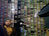 Saint John on a radio show, skowling.