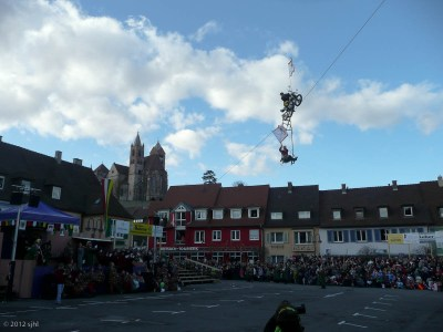 . . . across the courtyard while on a wire! Apparently he fell a few years ago while performing in Hamburg, Germany .