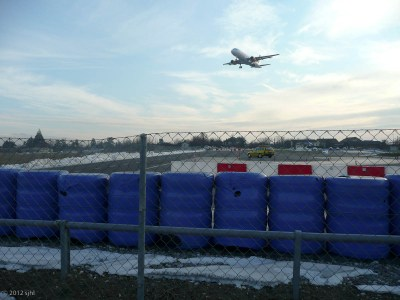 The Geneva airport's runway crosses the main road to CERN.