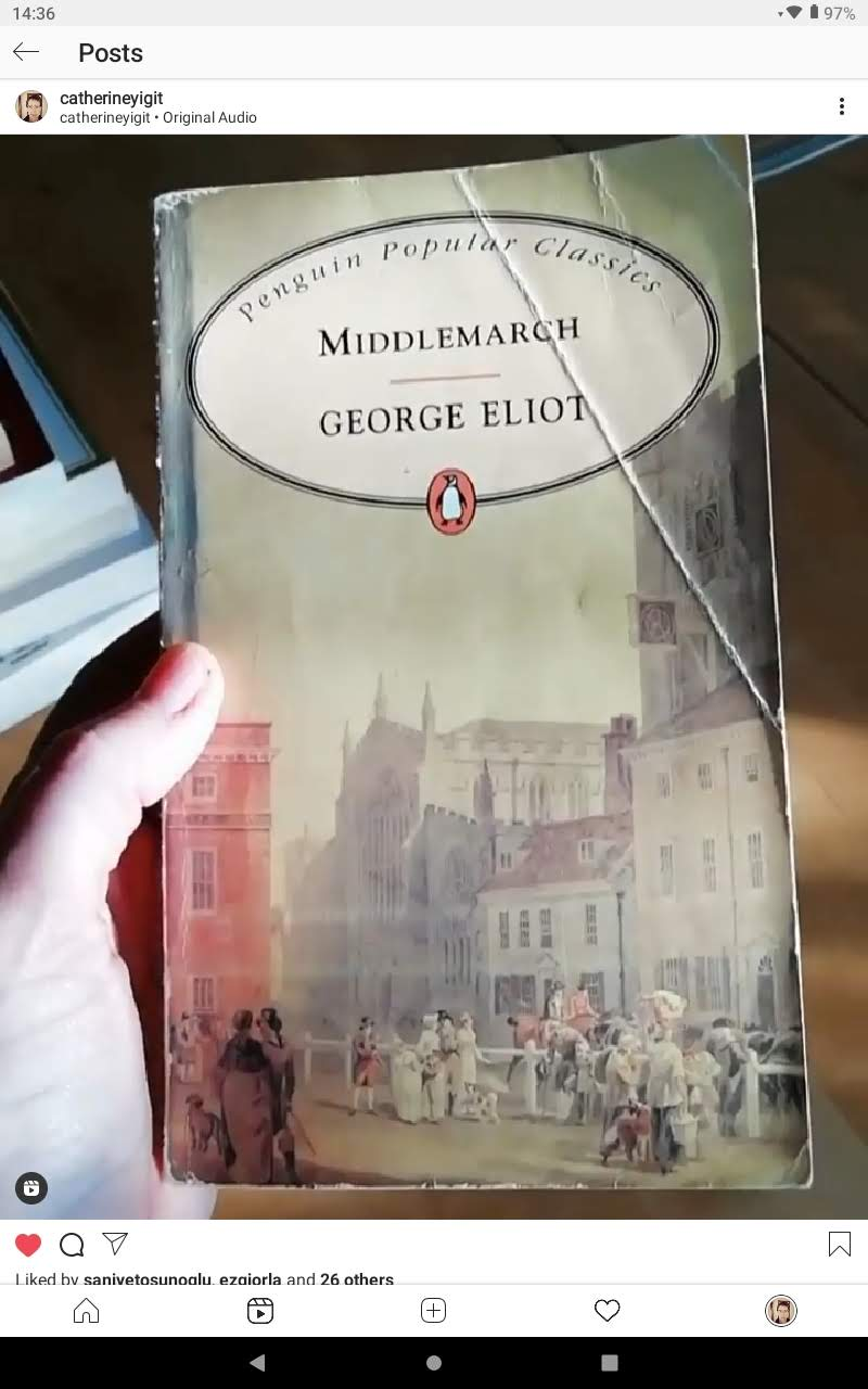A hand holding the book Middlemarch by George Eliot