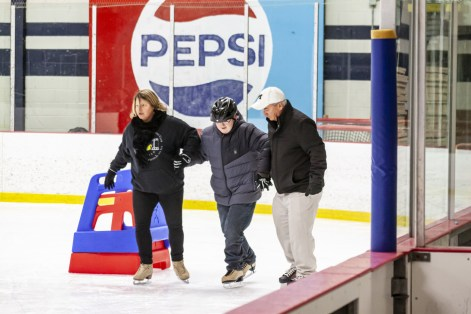 Coach Gail and Coach Doug teaching Learn to Skate