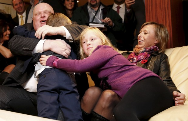Then Toronto Mayor Rob Ford (L) is congratulated by his children Doug and Stephanie as his wife Renata (R) looks on while watching the municipal election results in Toronto, in October 27, 2014 file photo. REUTERS/Mark Blinch/Files